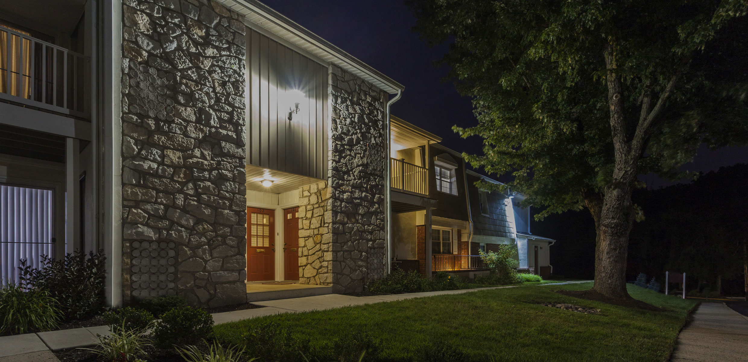 Exterior of Mill Grove Apartment at night